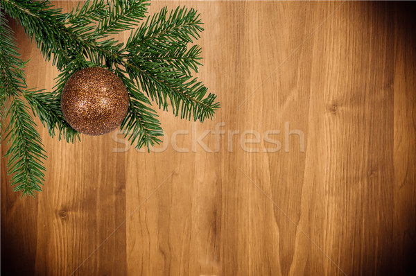 green branch with christmas ball on wooden background Stock photo © tarczas
