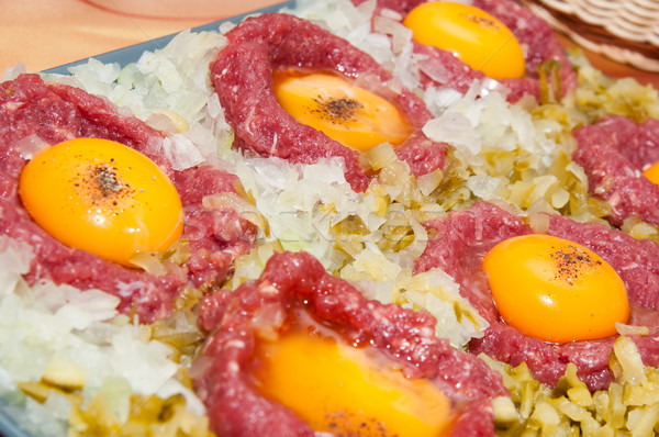 tartar steak with egg onion and pickle Stock photo © tarczas