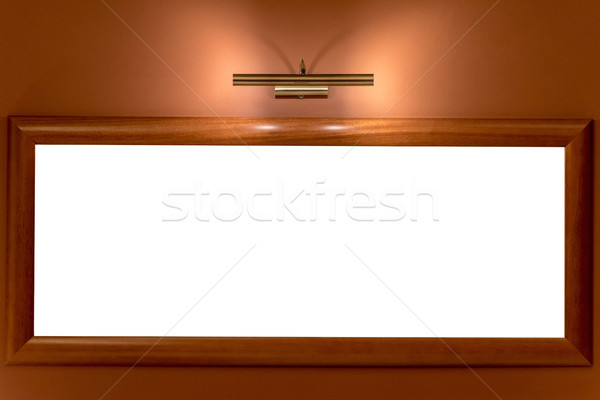 picture frame illuminated by lamp on the wall Stock photo © tarczas