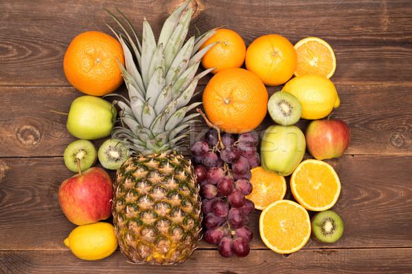 Smakelijk vruchten oranje kiwi druif appels Stockfoto © tarczas