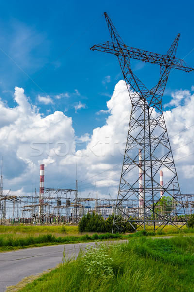 Pylon and transmission power line in summer day Stock photo © tarczas