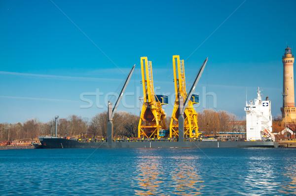 unloading a ship in the sea port Stock photo © tarczas