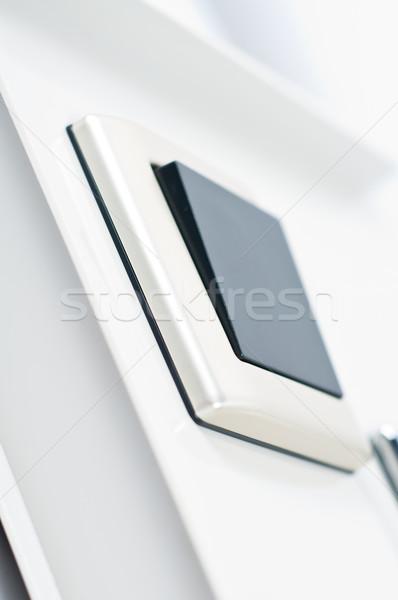 Interrupteur de lumière mur noir bouton blanche Photo stock © tarczas