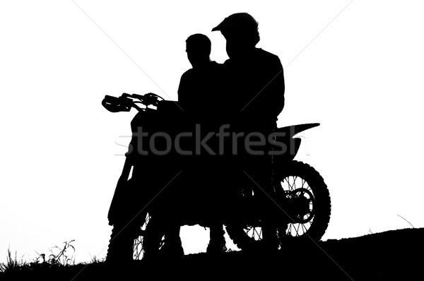 motocross biker silhouette during the sunset Stock photo © tarczas