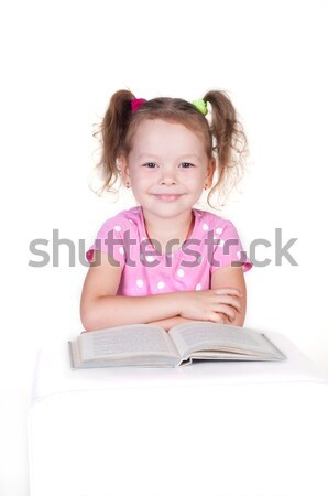 Cute little girl is reading a book Stock photo © TarikVision