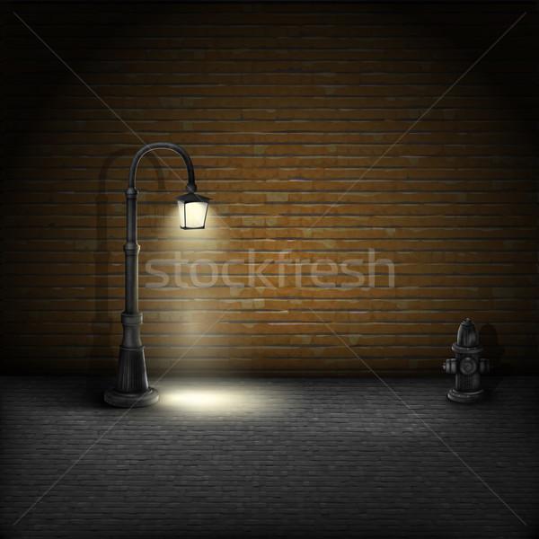 Vintage Streetlamp On Brick Wall Background. Stock photo © TarikVision