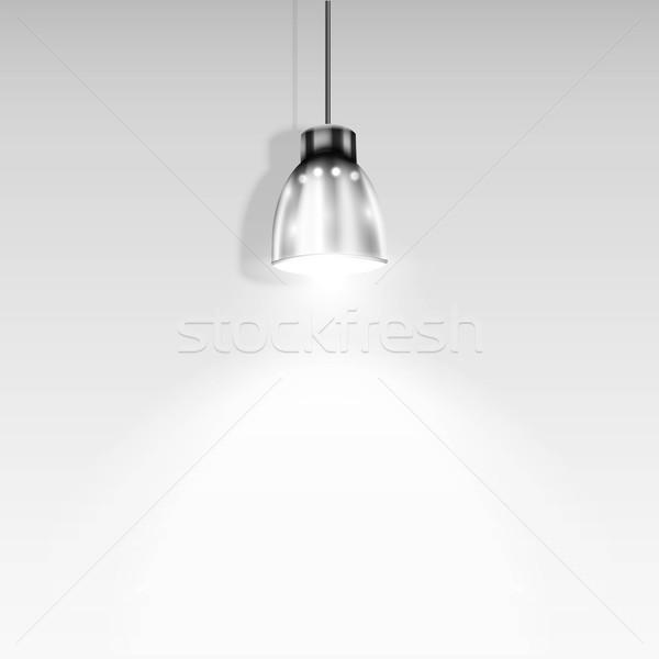 Single Spotlight Illuminating White Wall. Stock photo © TarikVision