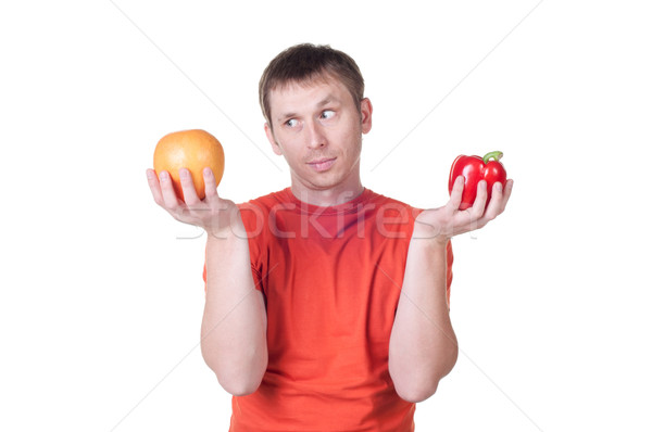young man hold in his hand fresh pepper and grapefruit Stock photo © TarikVision