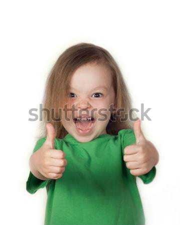 Portrait of a beautiful and confident girl showing thumbs up Stock photo © TarikVision