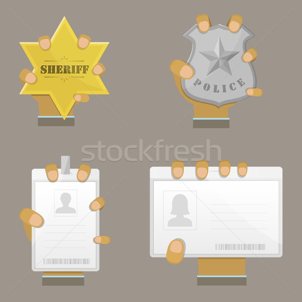 Mans Hand Holding Different Badges. Stock photo © TarikVision
