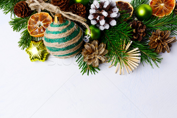 Christmas background with rustic ornaments and snowy decorated p Stock photo © TasiPas