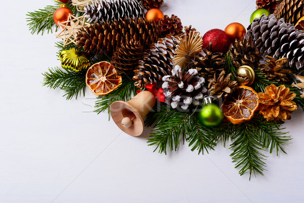 Handmade wooden Christmas jingle bell, fir branches and pine con Stock photo © TasiPas