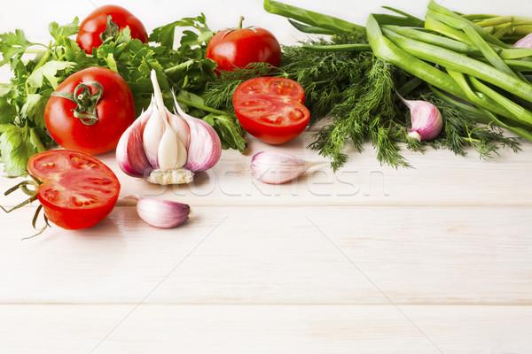 Garlic and tomato on the white wooden background Stock photo © TasiPas