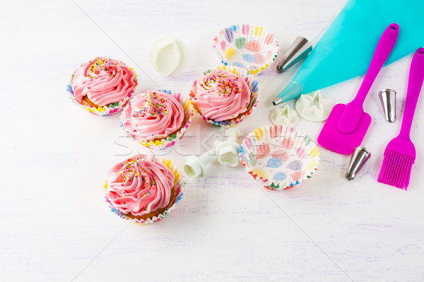Pink homemade cupcakes  and cookware Stock photo © TasiPas