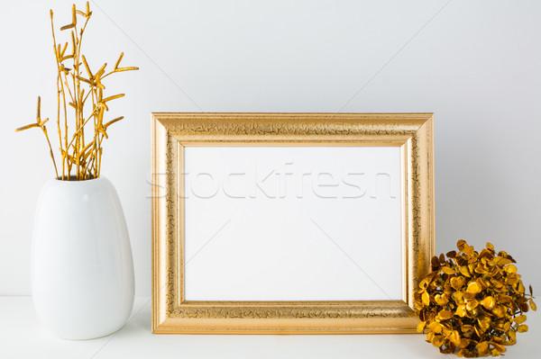 Landscape gold frame mockup with golden decor Stock photo © TasiPas