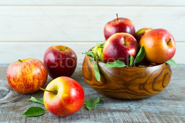 Fresh apples in the wooden bowl Stock photo © TasiPas