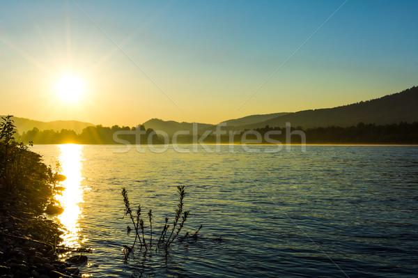 Nyár napfelkelte idilli folyó tájkép tó Stock fotó © TasiPas