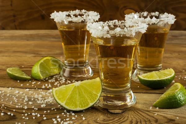 золото мексиканских текила извести соль Сток-фото © TasiPas