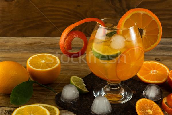 Pitcher of cool lemonade on wooden table Stock photo © TasiPas