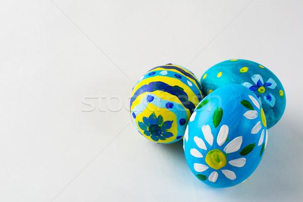 Blue hand-painted Easter eggs  Stock photo © TasiPas