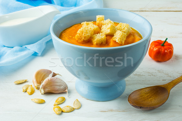 Stock photo: Creamy pumpkin soup in a blue bowl