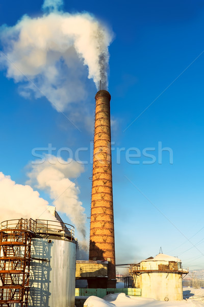Environmental dust concept with air pollution pipe Stock photo © TasiPas