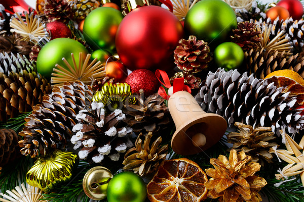 Christmas g background with red ornaments and snowy pine cones  Stock photo © TasiPas