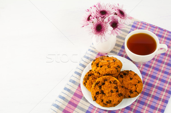 Homemade cookies and cup of tea on checkered napkin Stock photo © TasiPas