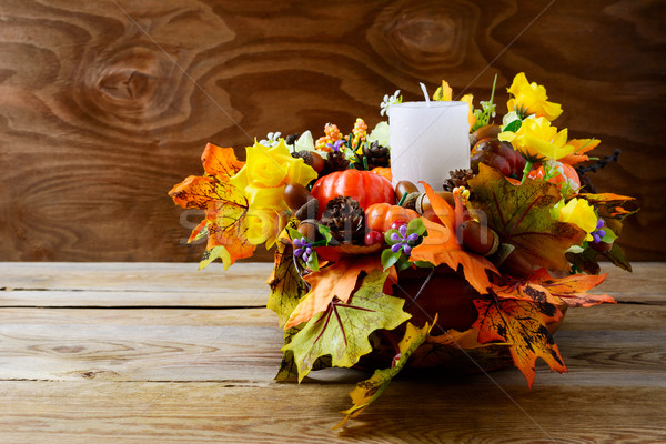 Thanksgiving decoration with white candle and silk fall leaves Stock photo © TasiPas