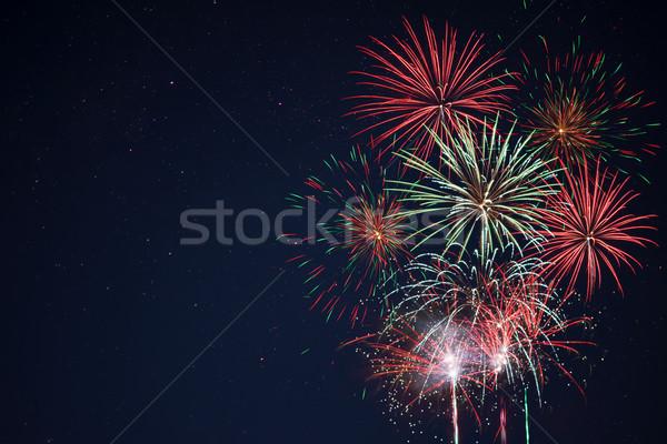 Vermelho verde amarelo fogos de artifício surpreendente Foto stock © TasiPas