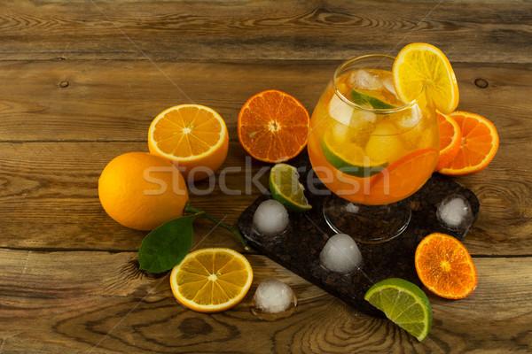Sürahi serin meyve kokteyl ahşap masa içmek Stok fotoğraf © TasiPas