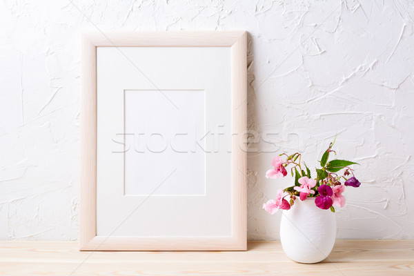 Wooden frame mockup with purple wildflowers in flowerpot Stock photo © TasiPas