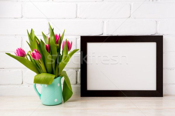 Black brown  landscape frame mockup with magenta tulips in mint  Stock photo © TasiPas