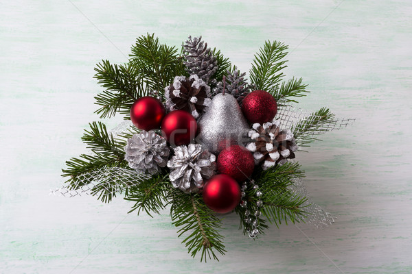 Christmas wreath with silver glitter pear and red ornaments Stock photo © TasiPas