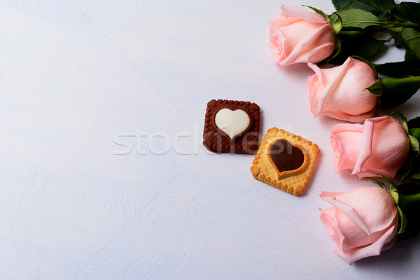 St. Valentine's Day background with roses, vanilla and chocolate Stock photo © TasiPas