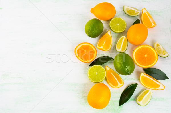 Citrus on light green background  Stock photo © TasiPas