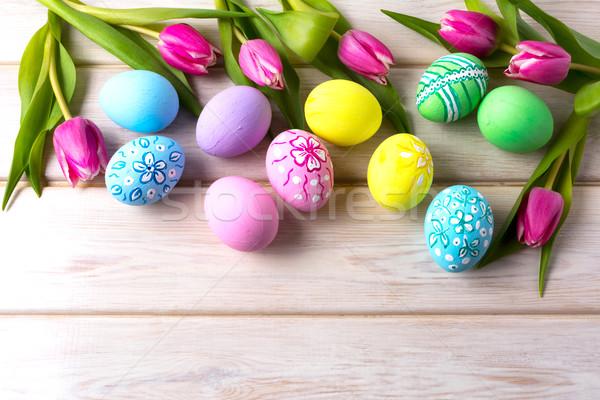 Húsvét tarka virágmintás díszített tojások tulipánok Stock fotó © TasiPas