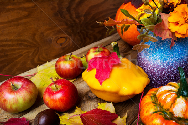 Ripe apples and yellow gourd Thanksgiving background Stock photo © TasiPas