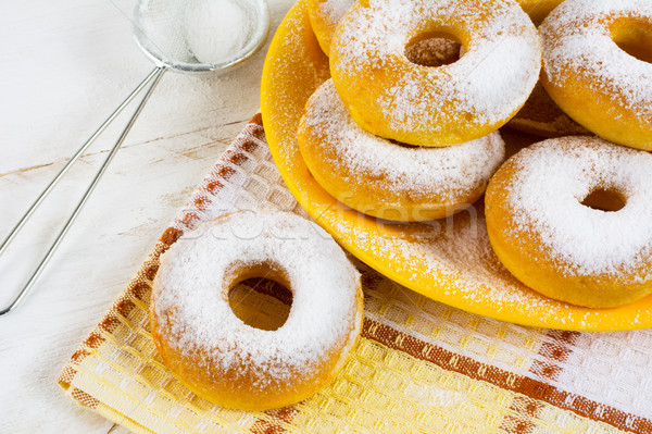Homemade sweet donuts with caster sugar on checkered napkin Stock photo © TasiPas