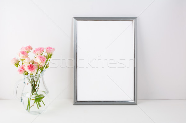 Silver frame mockup with pink roses Stock photo © TasiPas