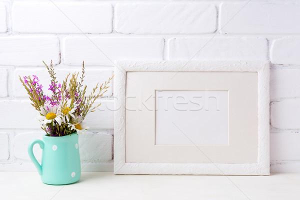 White landscape frame mockup with chamomile and purple flowers i Stock photo © TasiPas