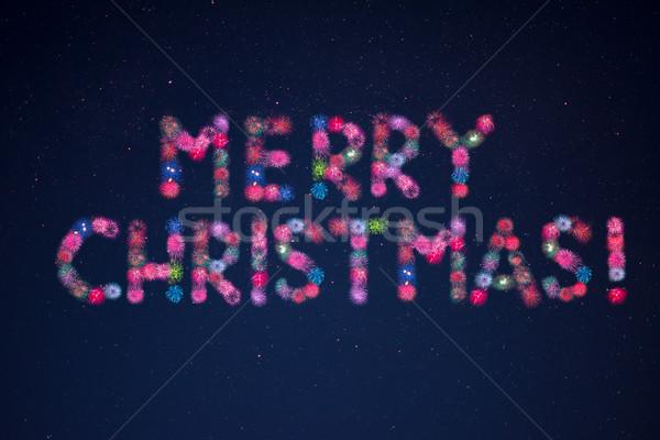 Celebration fireworks forming the words Merry Christmas Stock photo © TasiPas