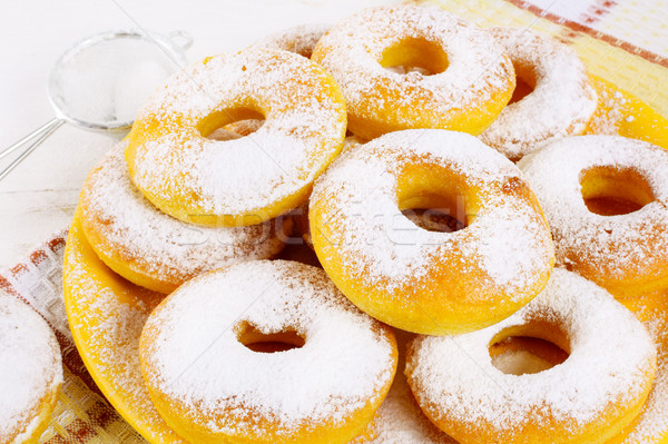 Stack of fried donuts on yellow plate  Stock photo © TasiPas
