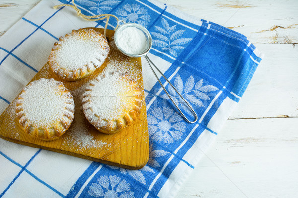 Small confiture pie on the cutting board Stock photo © TasiPas