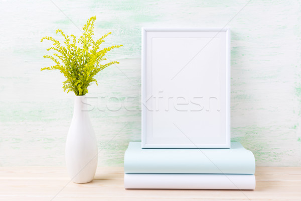 White frame mockup with ornamental green grass and books Stock photo © TasiPas