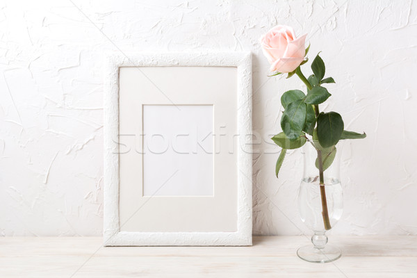 White frame mockup with rose in exquisite glass vase Stock photo © TasiPas