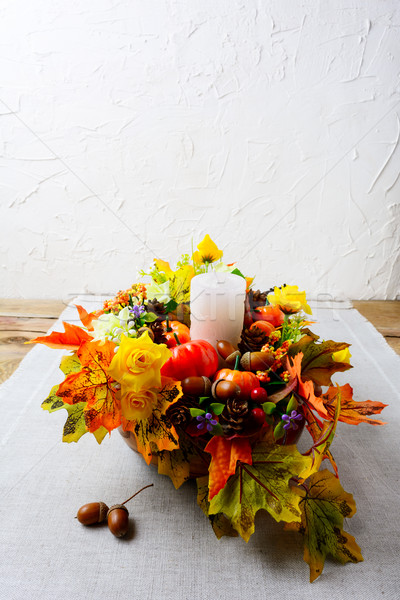 Thanksgiving decoration with silk fall leaves on linen napkin, v Stock photo © TasiPas