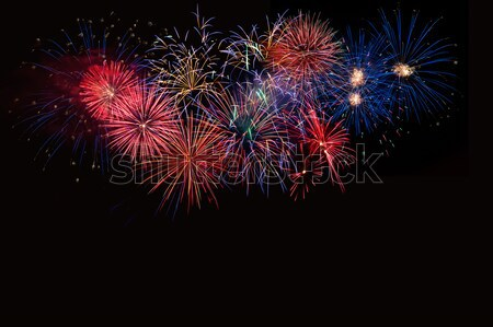 Red green yellow fireworks located left side  Stock photo © TasiPas