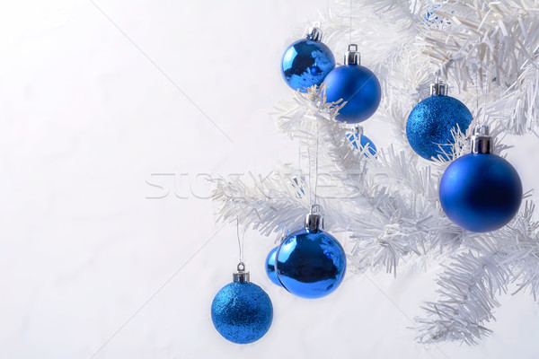 White Christmas tree with blue ornament copy space Stock photo © TasiPas