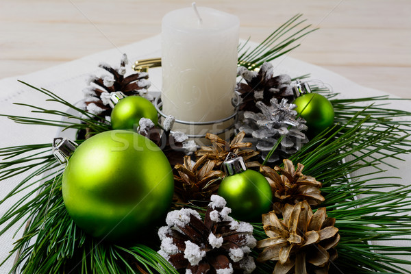 Christmas green ornaments and snowy pinecone decoration Stock photo © TasiPas